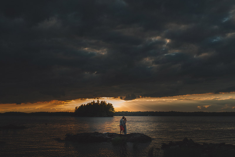 epic sunset photo of couple standing on private island
