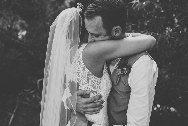 groom hugs bride after seeing her during their first look