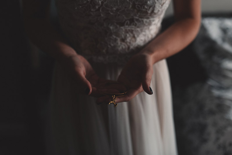 bride holds hummingbird bracelet in honour of her grandmother