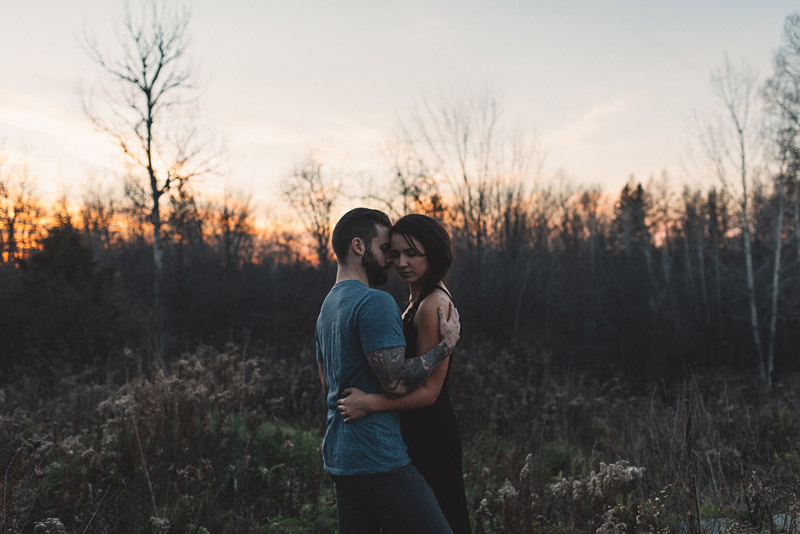 Couple embracing in chilly november sunset