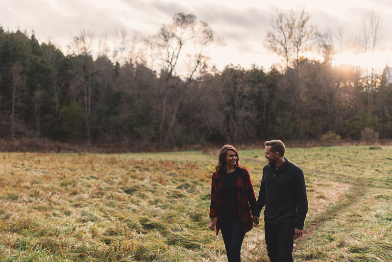 couple walking through and open field in gemmill park