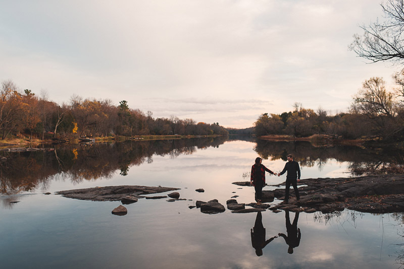couple walking on rocks at mississippi mills consevation area