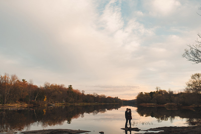 standing on a rock in the water together